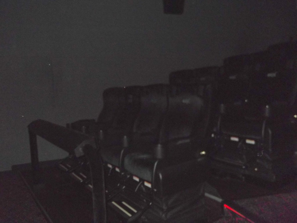 Sit in the movie theatre
